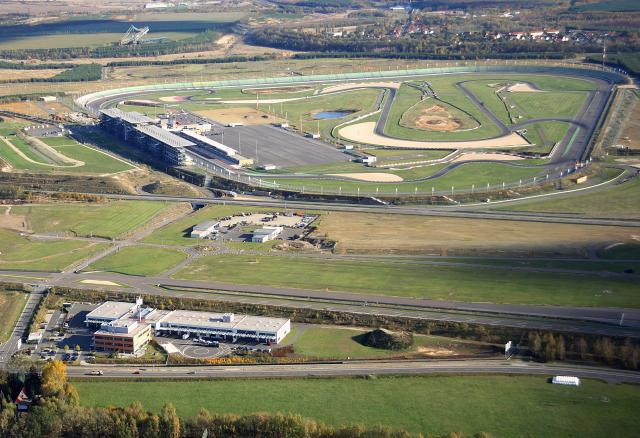 An aerial view of the Lausitzring (background) and DEKRA Technology Center (foreground)